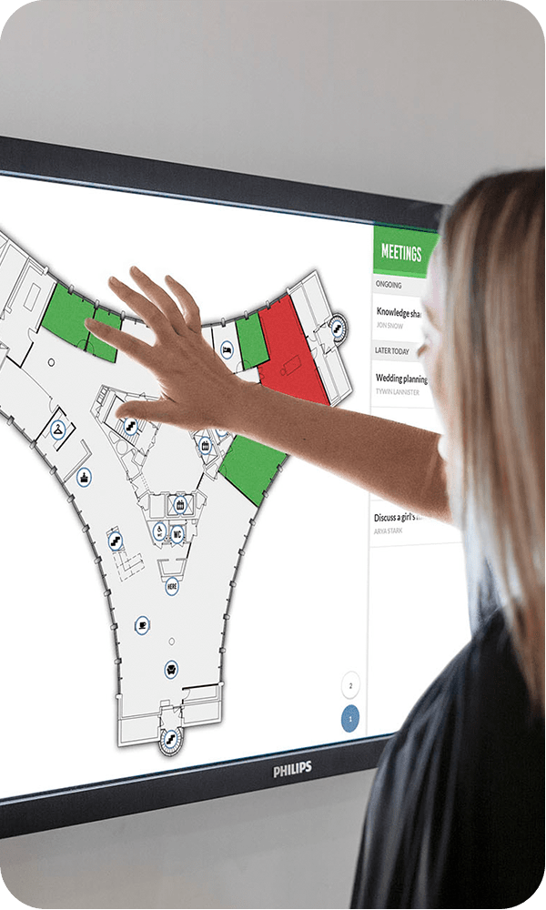 Booking a meeting room on a Meetio View touchscreen with floor plan map